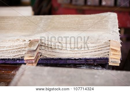 Stack of wet papers drying in factory