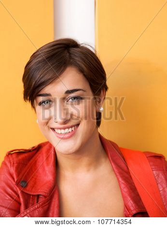 Portrait of confident female guitarist smiling in recording studio