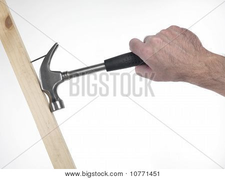 Hand Of Man With Hammer