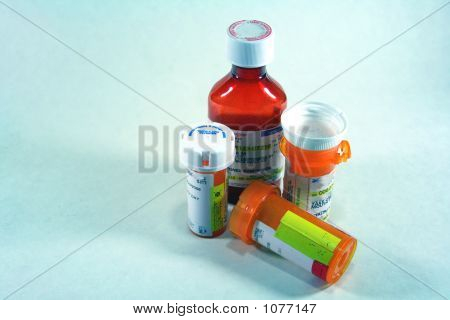4 Pill Bottles