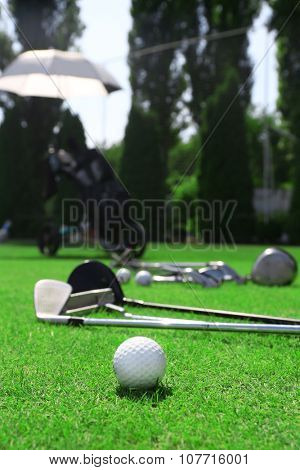 Golf clubs and ball on a luxury golf course, close up