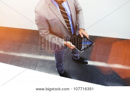 Young businessman holding digital tablet with blank copy space screen for promotional content