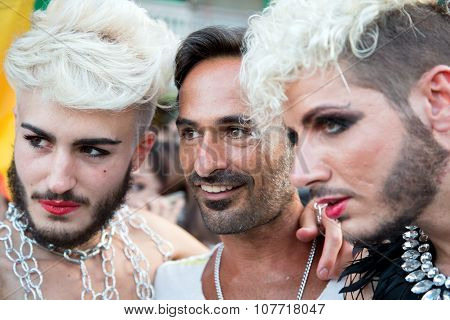 Naples, Italy, July 11 2015: Three Participants  In The Naples Gay Parade