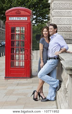 Romantic Couple By Traditional Red Phone Box In London, England