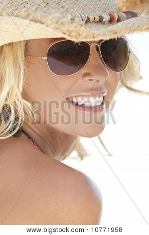 Sexy Blond Girl In Aviator Sunglasses And Straw Cowboy Hat