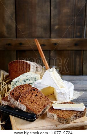 Slices Of Tasty Rye Bread, Camembert Cheese, Roquefort And Knife