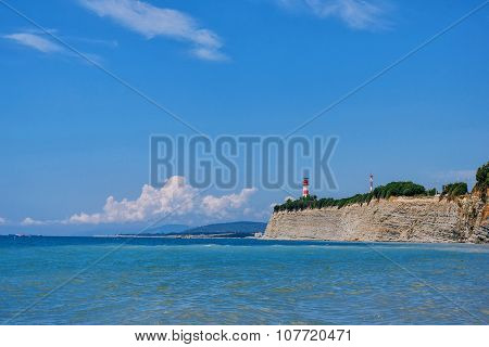 Seascape With Lighthouse On The Hill