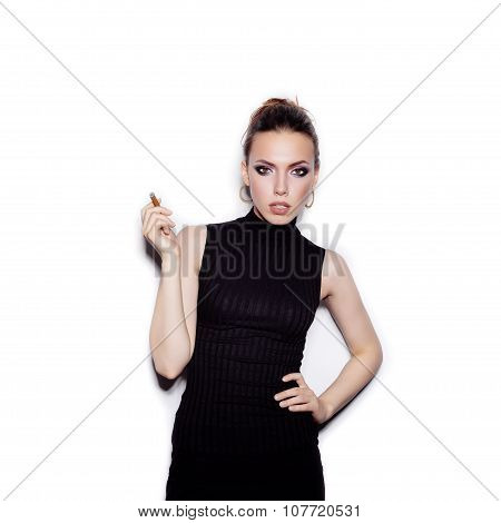 Portrait Of Fashionable Female Model With Cigarette Holder