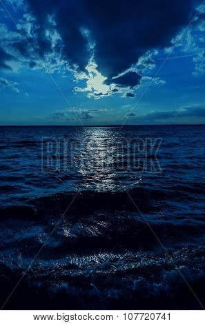 moonlight in sky over dark water