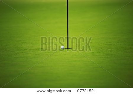 Green Field And Golf Ball On The Hole