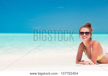 long haired girl in having fun on tropical barbados beach