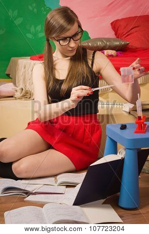 Pretty Student Looking At Test Tube