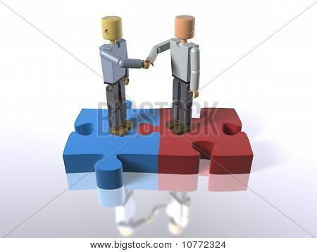 Standing on jigsaw pieces shaking hands