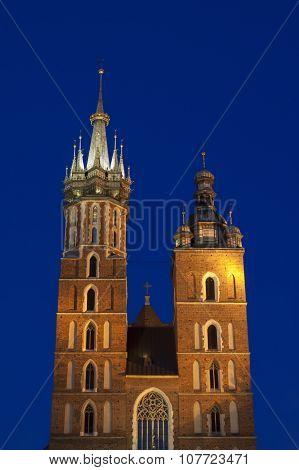 Poland, Krakow, Mariacki Church Towers Lit Up At Dusk