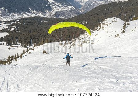 Paraglider Taking Off From A Snowy Slope