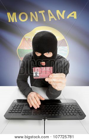 Hacker With Usa States Flag On Background And Id Card In Hand - Montana