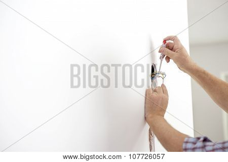 Electrician Checking The Presence Of Electrical Current In A Newly Installed  Wire