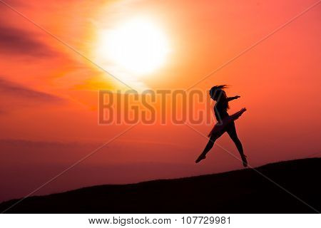 Ballerina In Silhouette In A Red Sunset