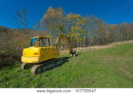 Excavator In A Meadow