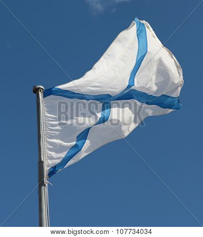 Russian Navy Ensign on a flag stick against blue sky