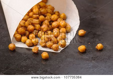 Chickpeas Baked With Spices Closeup On Black Metal Background With Place For Text