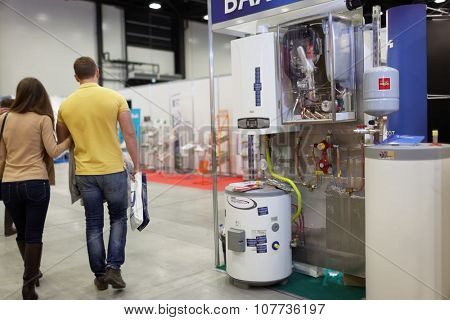 ST. PETERSBURG, RUSSIA - OCTOBER 31, 2015: Visitors and the exhibition of heating equipment of BAXI company during the Real Estate Fair in Expoforum. It is the largest real estate exhibition in Russia