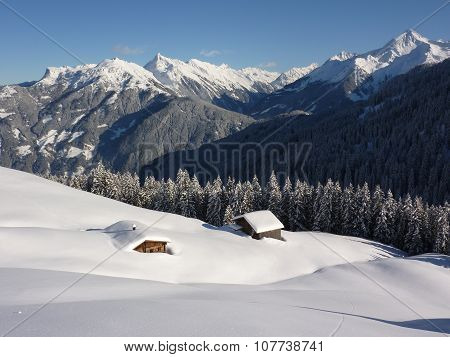 snowed ski huts in the Tyrolean mountains