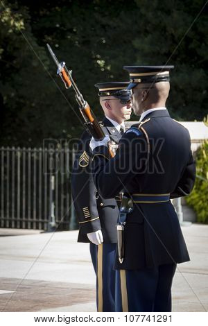 ARLINGTON, VA - SEPT 11, 2015: The relief commander and sentinel during the changing of the guard ceremony at the Tomb of the Unknown Soldier in Arlington National Cemetery.