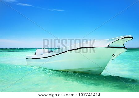 Sailing Boat In The Blue Carribean Sea And Beautiful Cloudscape