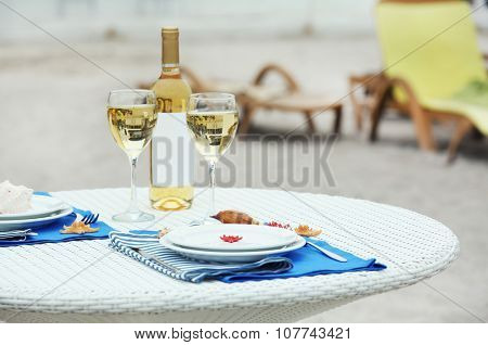 Served table on the sandy beach