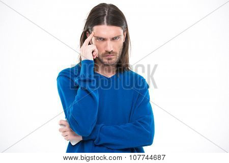 Angry mad man with long hair in blue pullover touching his temple