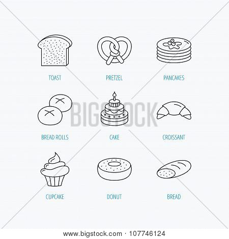 Croissant, pretzel and bread icons. Cupcake.