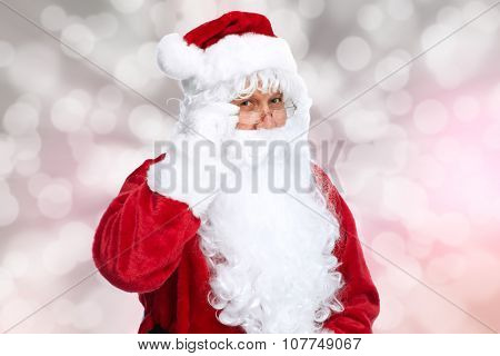 Santa Claus over sparkle Christmas abstract background.