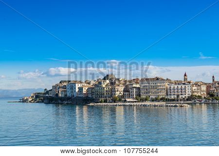 Corfu island cityscape from the sea with blue waters and sky.