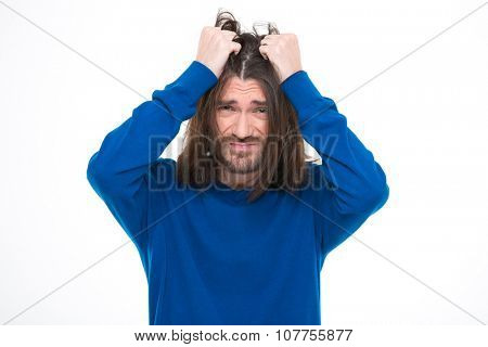 Depressive stresssed handsome man with long hair pluck his hair out