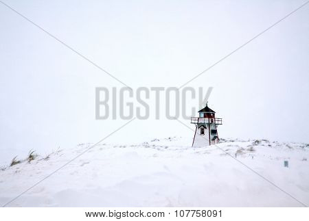 Lighthouse in Winter Snow