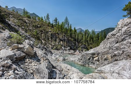 Bright Rocks In Narrow Valley Of Mountain Stream. Eastern Sayan. Buryatia