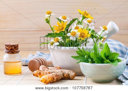 Alternative Health Care Fresh Herbal ,honey And Wild Flower With Mortar On Wooden Background.
