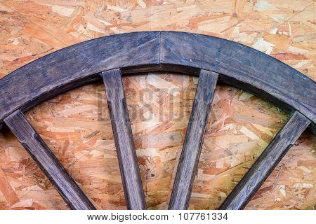 Wooden half cartwheel with texture for background.