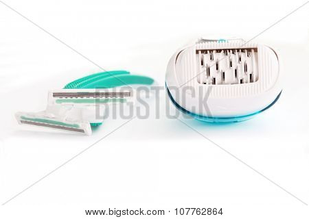 depilator and razor on white - beauty treatment