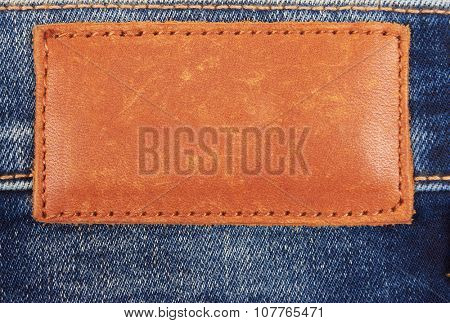 Blank leather jeans label on a blue jeans