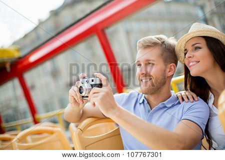 Smiling couple in a tour bus outdoors