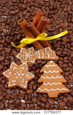 Decorated Gingerbread And Cinnamon Sticks On Coffee Grains, Christmas Time