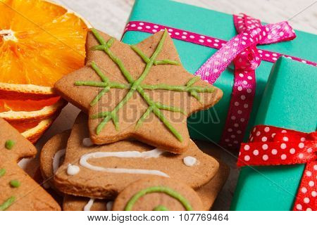 Gingerbread And Gifts For Christmas On Old Wooden Background, Christmas Time