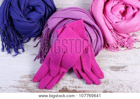 Woolen Gloves And Scarves For Woman On Old Wooden Background
