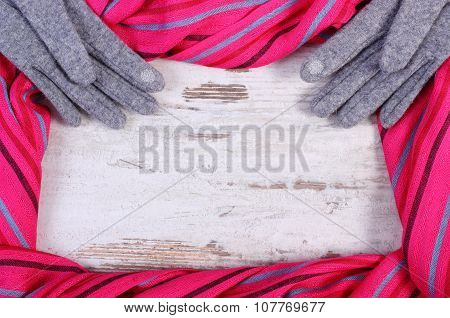 Woolen Gloves And Colorful Shawl With Copy Space For Text, Old Rustic Wooden Background