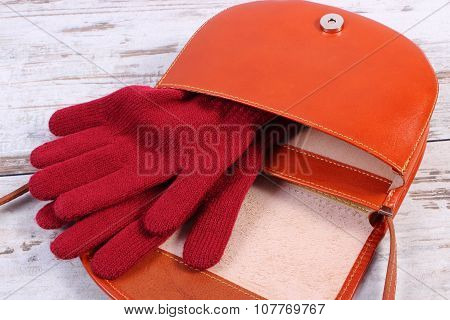 Woolen Gloves With Open Leather Handbag For Woman On Old Wooden Background