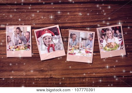 Instant photos on wooden floor against grandfather carving chicken during christmas dinner