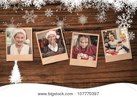 Instant photos on wooden floor against portrait of a pretty mature woman in santa hat