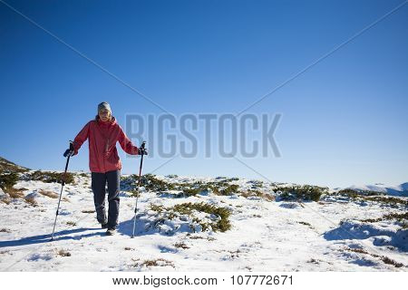 The Girl Walks Through The Snow In The Mountains.